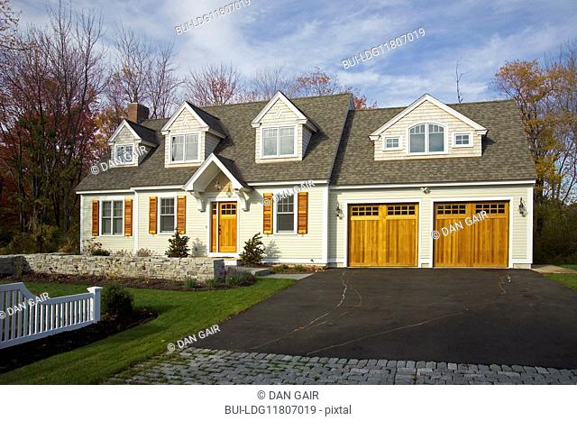 Driveway leading towards garage of single family home