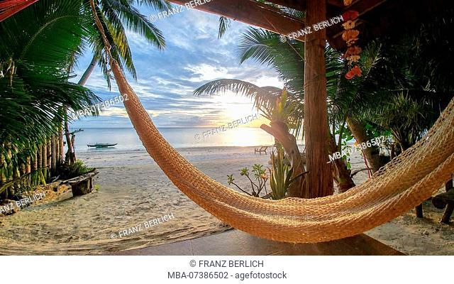 Philippines, hammock on the beach, sunset