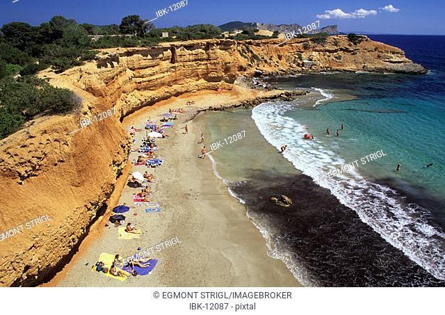 People on the beach of Cala sa Caleta or Bol Nou