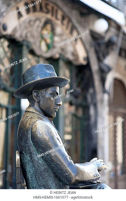 Portugal, Lisbon, Chiado district, Fernando Pessoa statue facing A Brasileira cafe