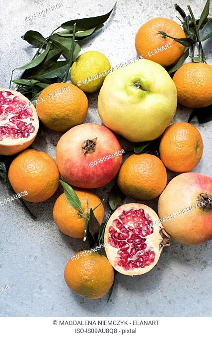 Overhead view of colourful fruits and halved pomegranate
