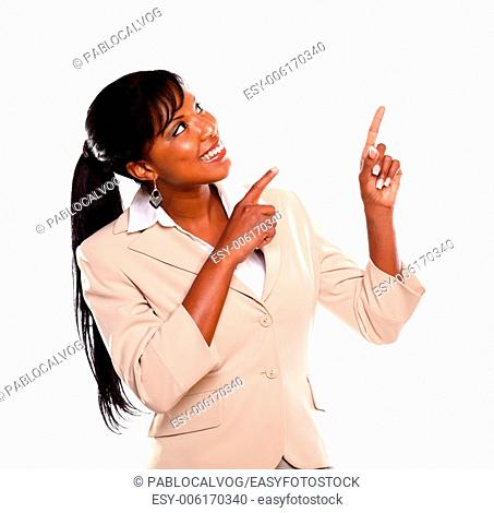 Adult businesswoman looking and pointing up on isolated background