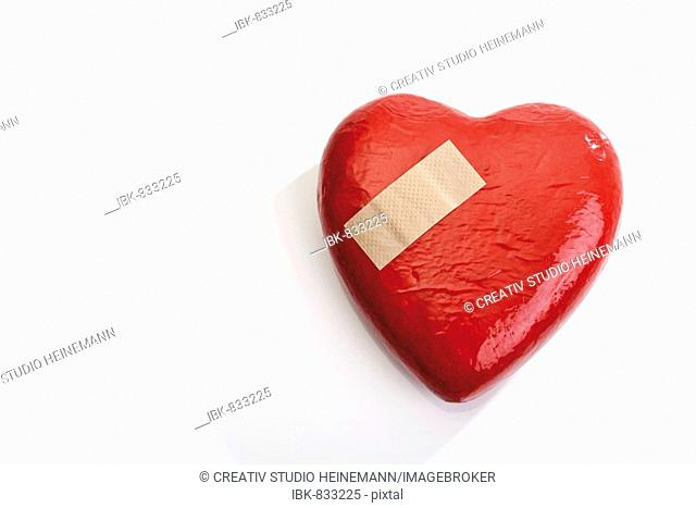 Adhesive plaster, band-aid on a heart