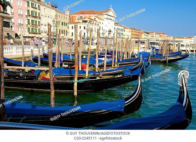 Gondolas on San Marco canal, along Riva degli Schiavoni, Castello, Venice, Italy