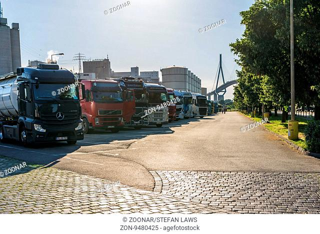 Row of Trucks waiting for loading soy oil from the vegetable oil company in the harbor of Hamburg. The company is one of the biggest for vegetable oil in...