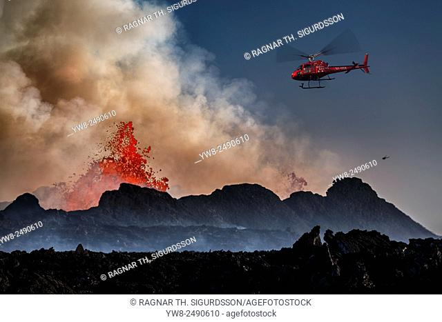 Helicopter flying over the volcano eruption at the Holuhruan Fissure, Bardarbunga Volcano, Iceland. August 29, 2014 a fissure eruption started in Holuhraun at...