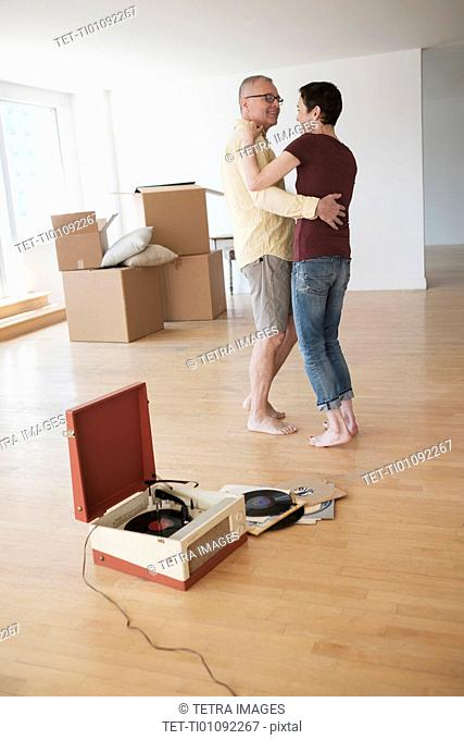 Couple dancing in new apartment