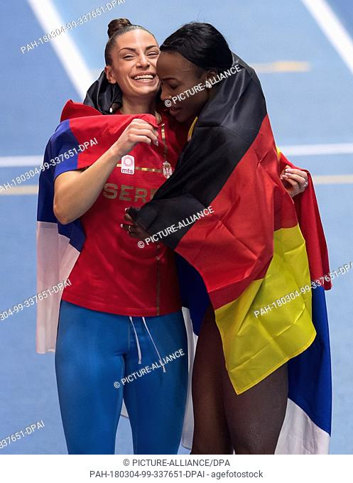 04 March 2018, Great Britain, Birmingham: IAAF World Indoor Championships. Serbia's Ivana Spanovic and Germany's Sosthene Moguenara-Taroum celebrating after the...