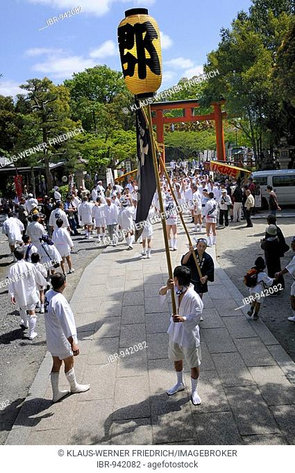 Carriers of the handles for the carrying frames of the shrine proceed singing and dancing toward the shrine, Matsuri Shrine Festival of the Matsuo Taisha Shrine
