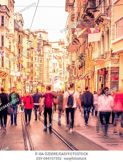 Long exposure or slow shutter speed and blurred image:Unidentified people walk at Istiklal street,popular destination in Istanbul,Turkey