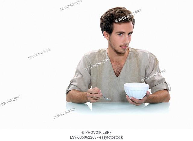 Man with a breakfast bowl