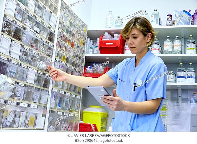 Nurse with a tablet in the pharmacy, Hospital Donostia, San Sebastian, Gipuzkoa, Basque Country, Spain