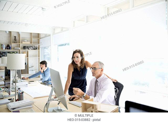 Architects working at computer in office