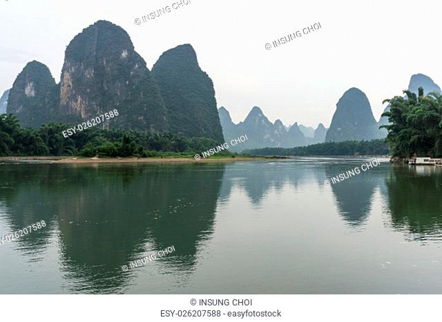 the famous 20 yuan banknote scenery taken early in the morning when the li river is calm. Taken in xingping, guilin, china. During summer