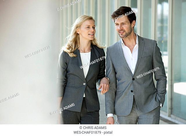 Portrait of two talking businesspeople