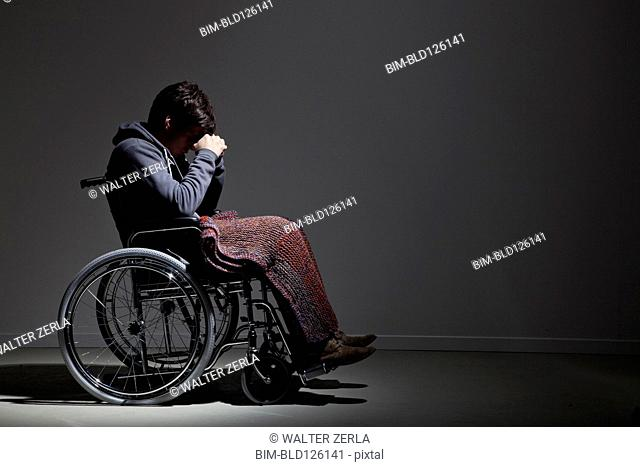 Frustrated Caucasian man in wheelchair