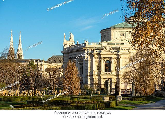 Views across famous Volksgarten (People's Garden) public park with historic Burgtheater (Austrian national theatre) in background, Vienna, Austria