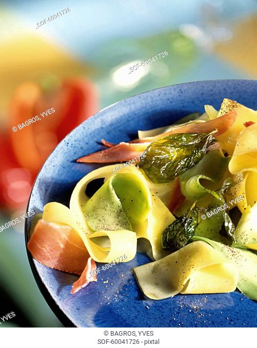 Tagliatelles with avocado,raw ham and fried basil leaves