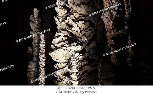 TILT up. CU. Stalagmites inside the cave. This is one of the show caves of France. It was discovered in 1897 by a shepherd, Louis Armand