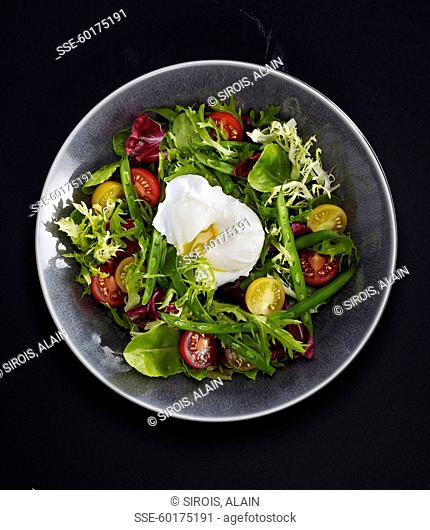 Green bean and yellow and red tomato salad with a soft-boiled egg