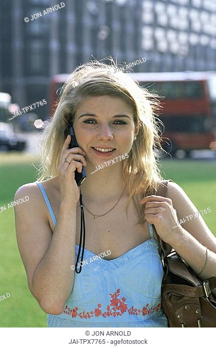 England,London,Female Tourist Talking on Moble Phone