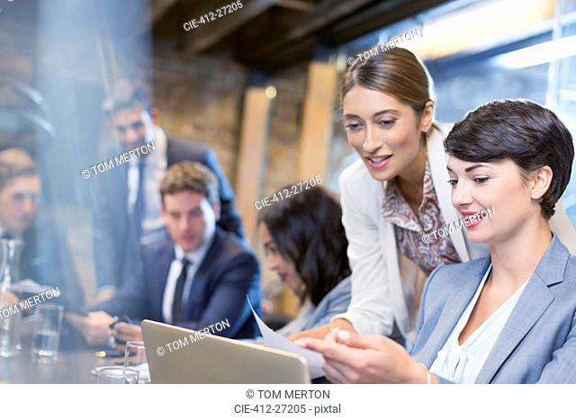 Businesswomen working with digital tablet in conference room meeting