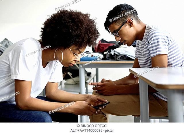 Students in classroom using smart phones