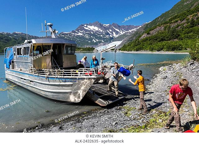 Family unloads gear from water taxi boat at Shoup Bay, Shoup Bay State Marine Park, Prince William Sound, Valdez, Southcentral Alaska