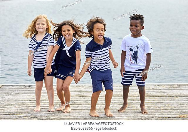 Children with sea clothes, Marina Urola, Santiago beach, Zumaia, Gipuzkoa, Basque Country, Spain, Europe