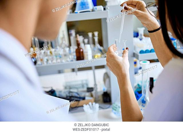 Young woman pipetting in laboratory