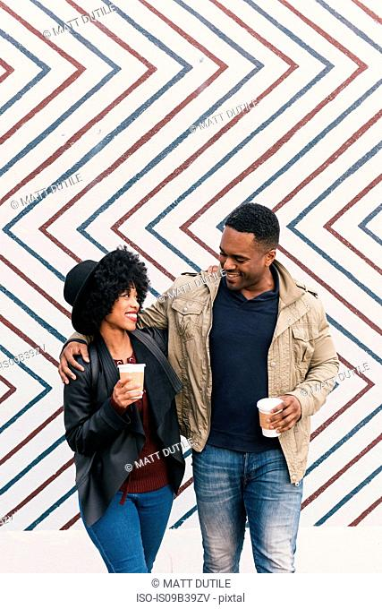 Couple in front of zig zag pattern wall