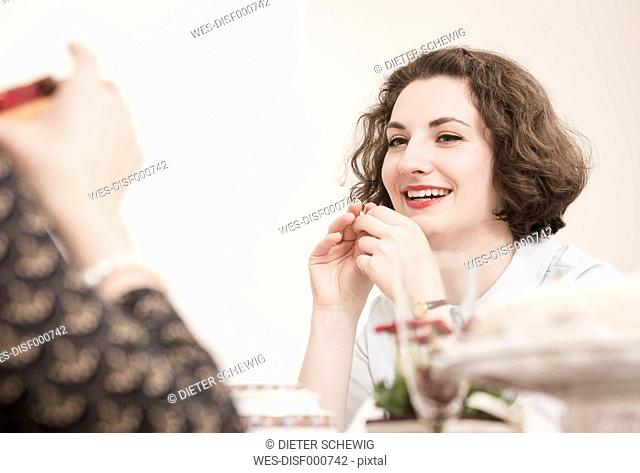 Two young women on a retro style tea party