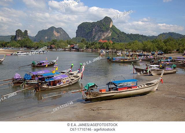 Long tailed boats and limestone karsts Krabi Thailand