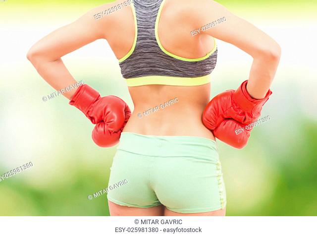 Fitness Slim Sporty Woman Body ,with boxing gloves, athletic women showing her thin waist, Healthy lifestyle