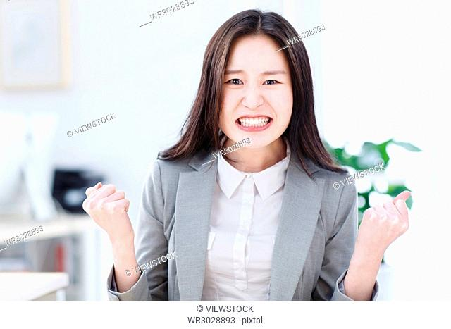 A business woman with a crazy facial expression