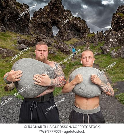 Strong men brothers holding heavy stones, Djupalonssandur, Snaefellsnes Peninsula, Iceland