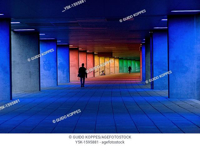 Zone or passageway for pedestrians under the Dutch Institute for Architecture in Rotterdam. The passageway is lighted with different kinds of colors blue, res