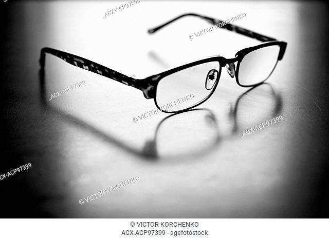 Eyeglasses on a white sheet of paper