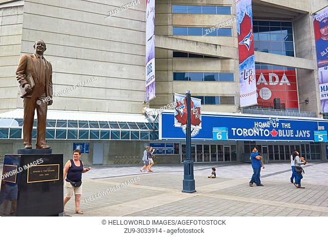 Statue of Ted Rogers (businessman and philanthropist) outside the Rogers Centre (1989), Toronto, Ontario, Canada. . Sports and events venue and home to baseball...