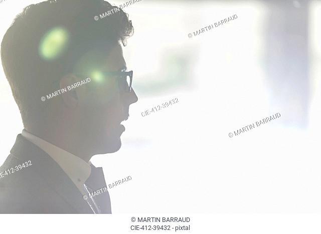 Silhouette profile businessman in eyeglasses looking away