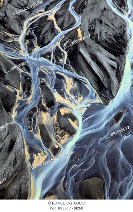 Aerail view of waterfall and meandering glacial river, Landmannalaugar, Iceland
