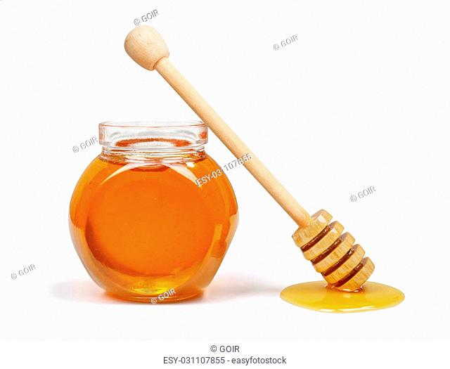 Honey pot and honey dipper isolated on white background
