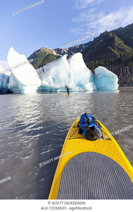 POV from a stand up paddleboarder of Grewingk Glacier and fellow paddleboarder, Kachemak Bay State Park, Southcentral Alaska