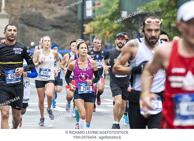 Runners pass through Harlem in New York near the 22 mile mark near Mount Morris Park on Sunday, November 5, 2017 in the 47th annual TCS New York City Marathon
