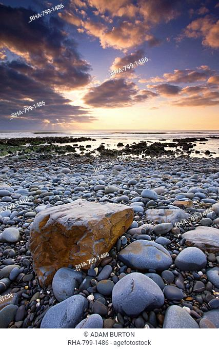 Sunset over the Atlantic from the pebbly shores of Sandymouth, Cornwall, England, United Kingdom, Europe