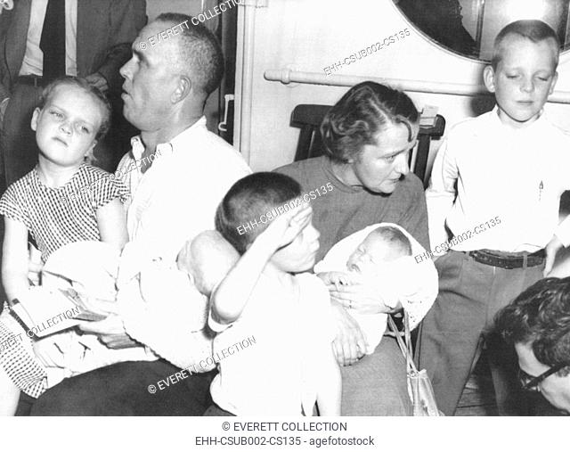 Survivors of the ill-fated Italian liner Andrea Doria, July 26, 1956. Mr. and Mrs. Ellis Hill, of Detroit, Michigan pose with their five children aboard the...