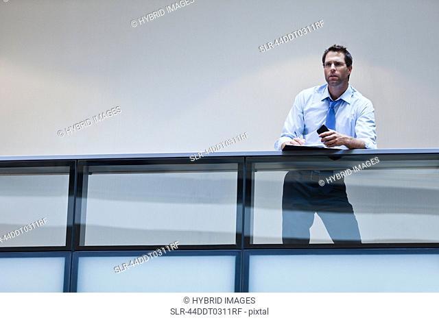 Businessman working on balcony