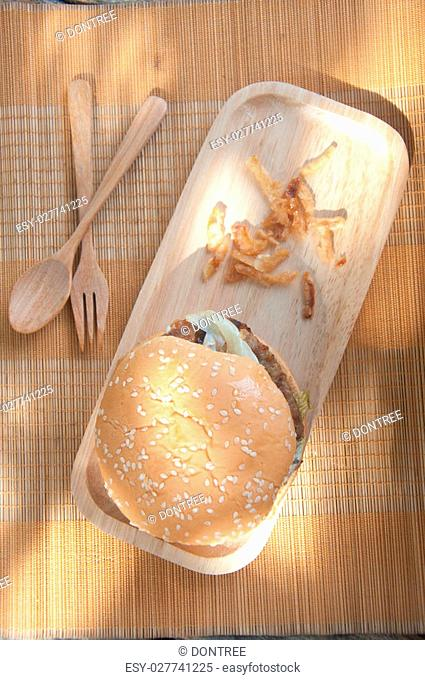 Homemade traditional hamburgers pork in wood tray on mat