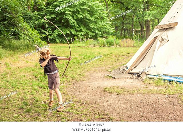Germany, Saxony, Indians and cowboy party, Boy playing with bow and arrow