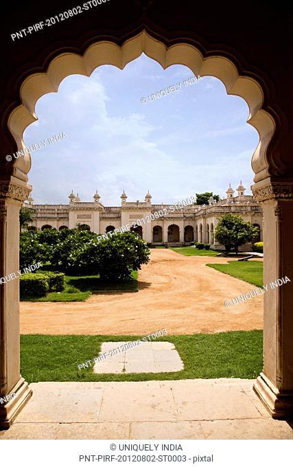 Facade view through arch, Chowmahalla Palace, Hyderabad, Andhra Pradesh, India